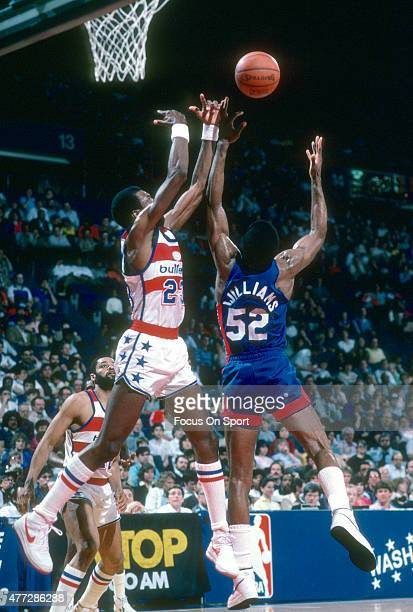 Buck Williams of the New Jersey Nets battles for a rebound with Charles Jones of the Washington Bullets during an NBA basketball game circa 1984 at...