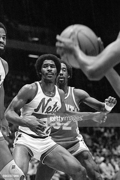Buck Williams of the New Jersey Nets defends Dan Roundfield of the Atlanta Hawks during an inbound play at Brendan Byrne Arena in East Rutherford New...