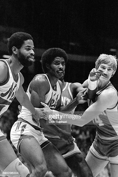 Buck Williams of the New Jersey Nets defends Tom McMillen of the Atlanta Hawks during an inbound play at Brendan Byrne Arena in East Rutherford New...