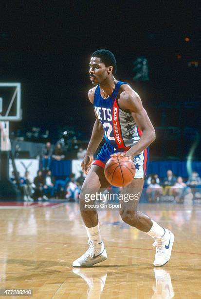 Buck Williams of the New Jersey Nets dribbles the ball against the Washington Bullets during an NBA basketball game circa 1984 at the Capital Centre...