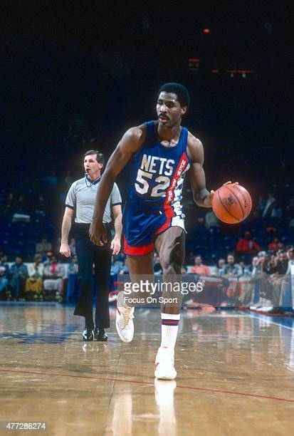 Buck Williams of the New Jersey Nets dribbles the ball up court against the Washington Bullets during an NBA basketball game circa 1983 at the...