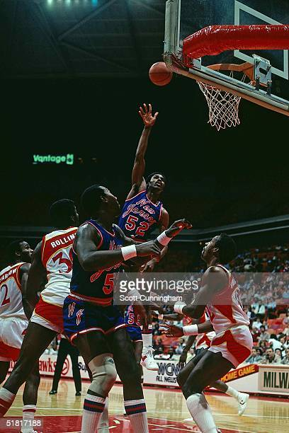 Buck Williams of the New Jersey Nets goes for a layup against the Atlanta Hawks during the NBA game circa 1982 in Atlanta Georgia NOTE TO USER User...