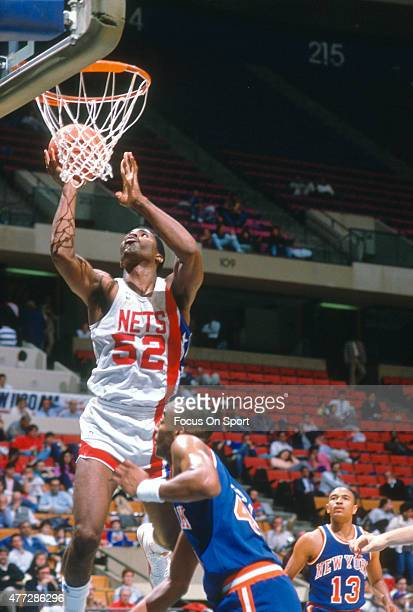 Buck Williams of the New Jersey Nets goes up to shoot against the New York Knicks during an NBA basketball game circa 1984 at the Rutgers Athletic...