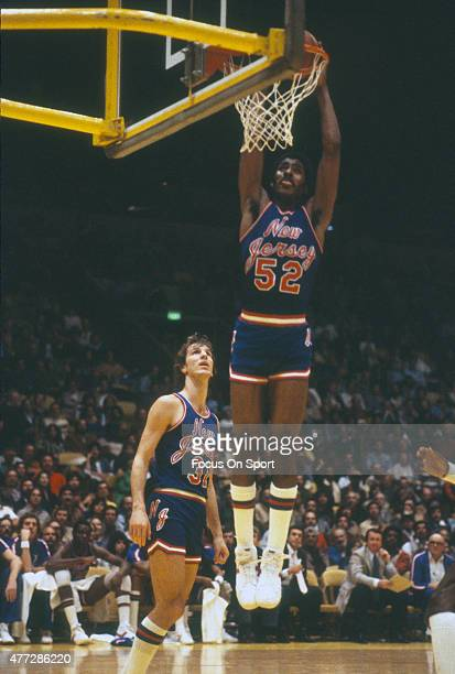 Buck Williams of the New Jersey Nets goes up to slam dunk the ball during an NBA basketball game circa 1981 Williams played for the Nets from 198189