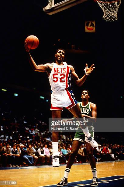 Buck Williams of the New Jersey Nets grabs a rebound against the Boston Celtics in 1986 at The Brendan Byrne Arena in East Rutherford New Jersey NOTE...