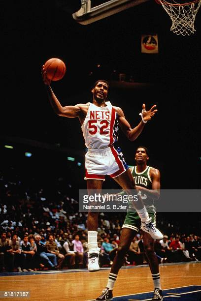 Buck Williams of the New Jersey Nets grabs a rebound against the Boston Celtics during the NBA game circa 1986 at the Brendan Byrne Arena in East...