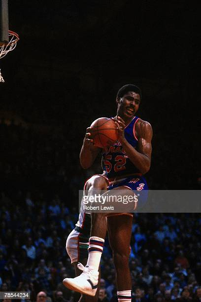 Buck Williams of the New Jersey Nets grabs a rebound against the Milwaukee Bucks during an 1980s NBA game at the MECCA in Milwaukee Wisconsin NOTE TO...