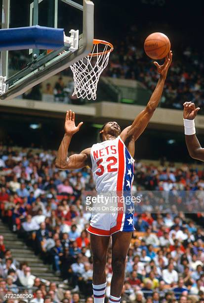 Buck Williams of the New Jersey Nets grabs a rebound during an NBA basketball game circa 1984 at the Rutgers Athletic Center in Piscataway New Jersey...