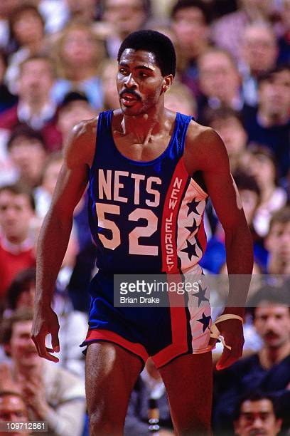 Buck Williams of the New Jersey Nets looks on against the Portland Trailblazers during a game played circa 1985 at Memorial Coliseum in Portland...