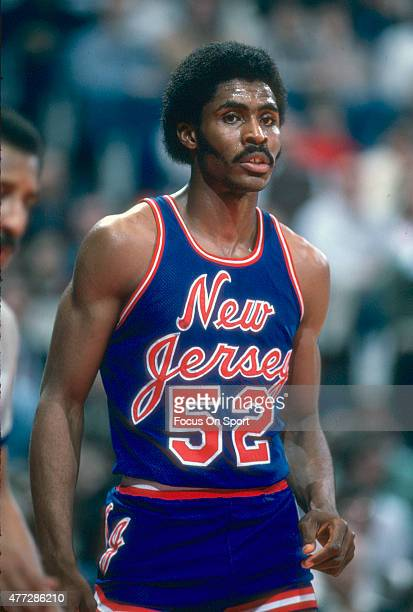 Buck Williams of the New Jersey Nets looks on during a break in the action against the Washington Bullets during an NBA basketball game circa 1981 at...