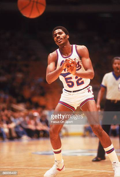 Buck Williams of the New Jersey Nets passes to a teammate circa the 1980's during a game