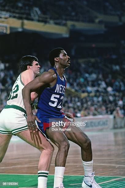 Buck Williams of the New Jersey Nets posts up against Kevin McHale of the Boston Celtics during a game played in 1985 at the Boston Garden in Boston...