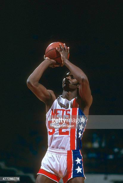 Buck Williams of the New Jersey Nets shoots a free throw during an NBA basketball game circa 1981 at the Rutgers Athletic Center in Piscataway New...