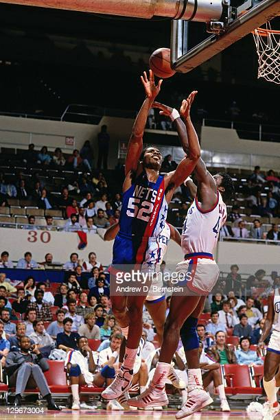 Buck Williams of the New Jersey Nets shoots against the Los Angeles Clippers circa 1987 at the LA Sports Arena in Los Angeles California NOTE TO USER...