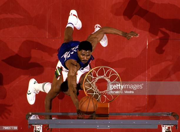 Buck Williams of the New Jersey Nets shoots during the 1984 NBA Playoffs against the Milwaukee Bucks in May 1984 in East Rutherford New Jersey