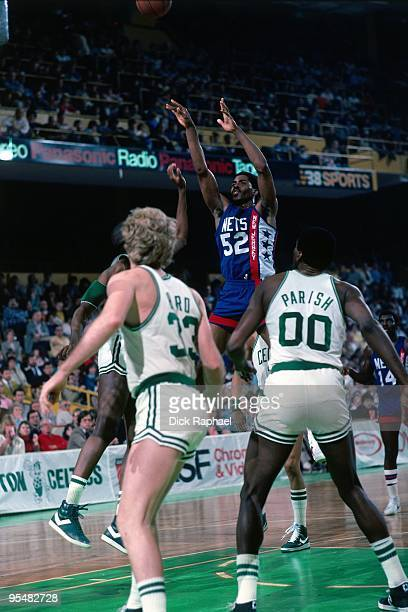 Buck Williams of the New Jersey Nets shoots over Larry Bird of the Boston Celtics during a game played in 1984 at the Boston Garden in Boston...
