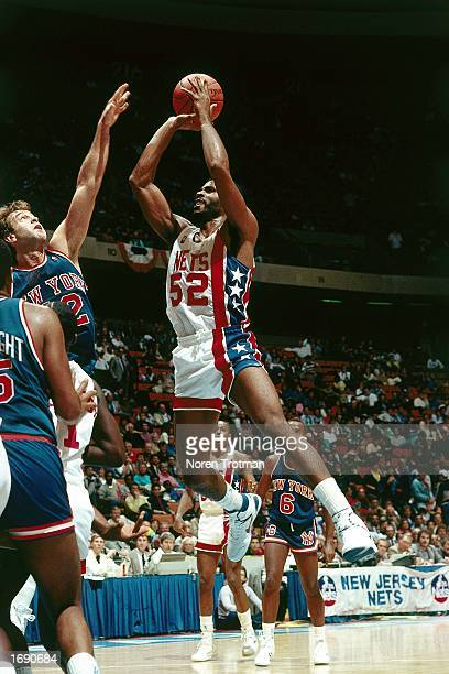 Buck Williams of the New Jersey Nets takes a jumper during the 1984 NBA game against the Detroit Pistons at the Brendan Byrne Arena in East...