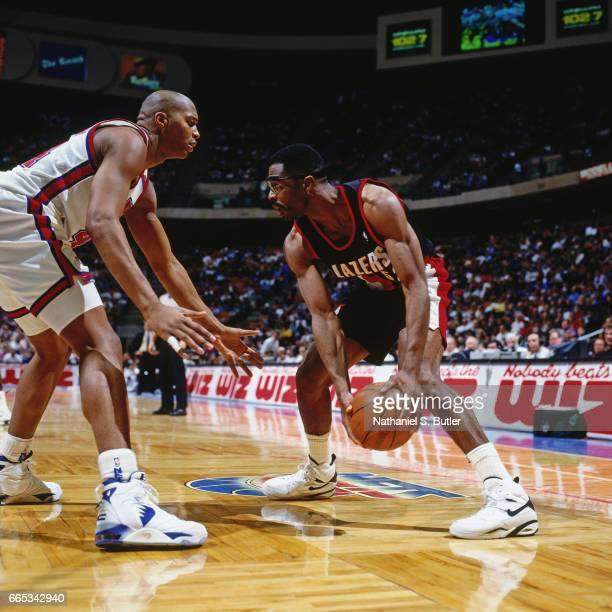 Buck Williams of the Portland Trail Blazers drives against the New Jersey Nets during a game played circa 1993 at the Brendan Byrne Arena in East...
