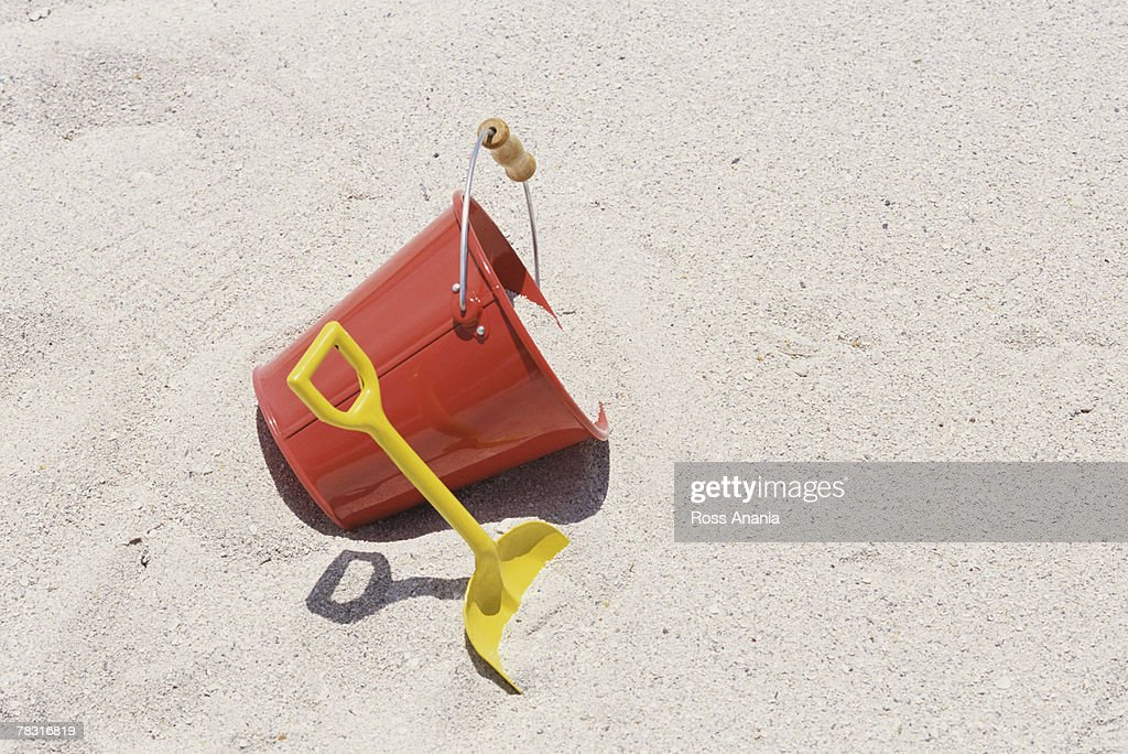 Bucket and shovel in sand