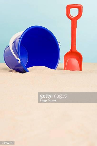 Bucket and spade on beach