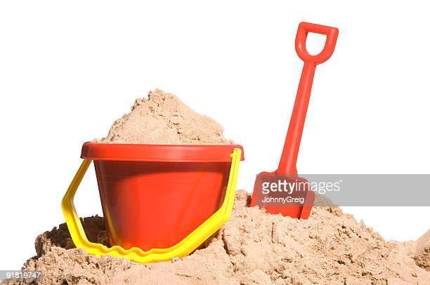 Paletta e secchiello con sabbia