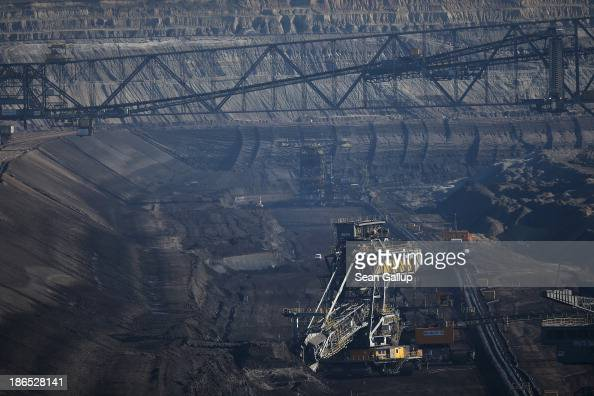A bucket excavator six storeys tall mines lignite coal at the Jaenschwalde openpit coal mine on October 31 2013 near Jaenschwalde Germany According...