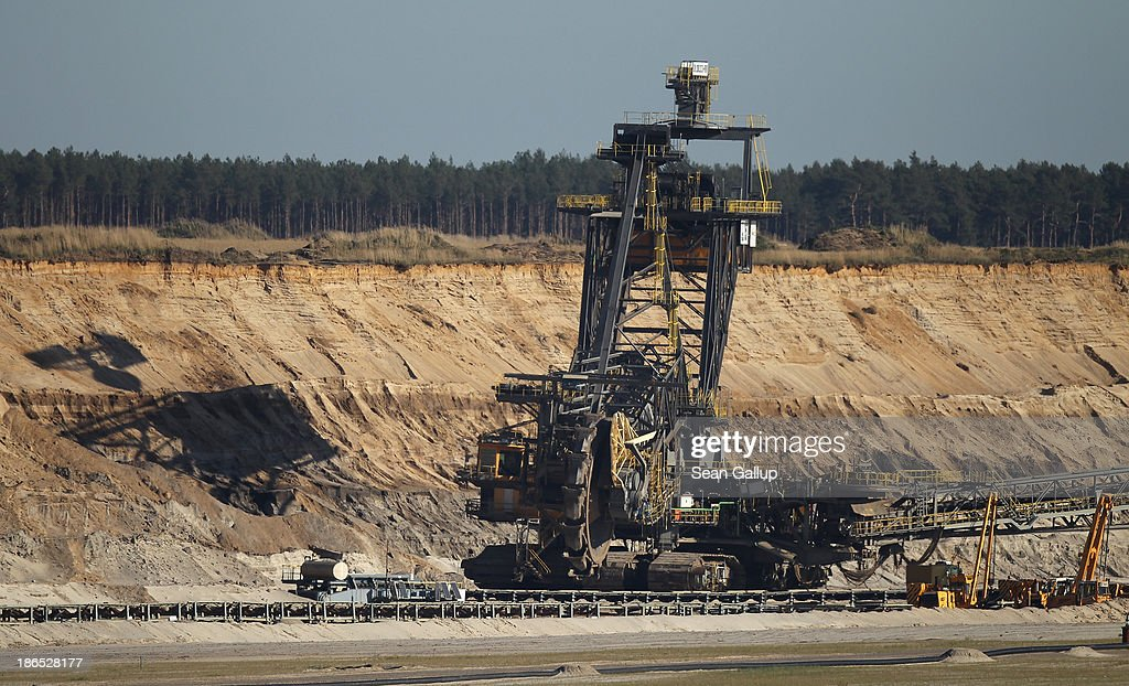 A bucket excavator stands idle while removing the top layers of soil in the first stage of reaching lignite coal underneath at the Jaenschwalde open-pit coal mine on October 31, 2013 near Jaenschwalde, Germany. According to plans by Swedish energy conglomerate Vattenfall and approved by the Brandenburg state legislature, at least five local communities are to be raized and their inhabitants compensated and relocated in order to make way for the expansion of the mine. Energy policy and the role of coal is a heated topic at the moment in coalition negotiations between the Social Democrats (SPD) and Christian Democrats (CDU) currently taking place in Berlin.