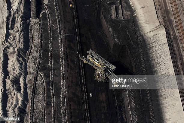 A bucket excavator the size of an office building extracts lignite coal from the ground at the openpit coal mine at Jaenschwalde on August 20 2010...