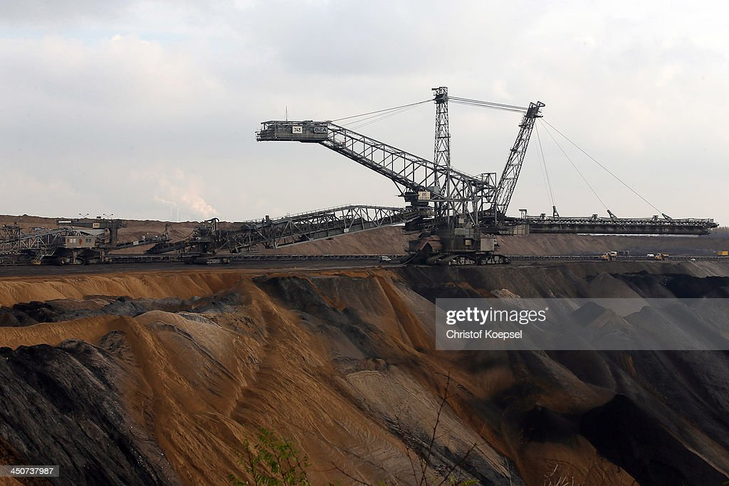 Bucket excavators dig lignite coal out of the ground at the Garzweiler open-pit coal mine at Jackerath view point on November 19, 2013 near Bergheim, Germany. RWE, the energy company that owns the Garzweiler mine, is struggling to remain profitable as Germany switches away from nuclear to renewable energy sources. Many of the company's coal-fired plants are no longer profitable and the company is considering closing the Garzweiler mine by 2018.