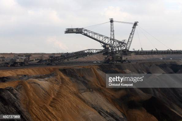 Bucket excavators dig lignite coal out of the ground at the Garzweiler openpit coal mine at Jackerath view point on November 19 2013 near Bergheim...