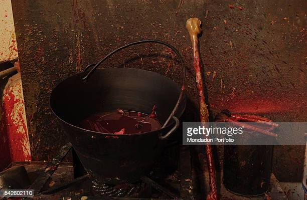 A bucket for melted wax and some tools to work it in Battaglia artistic foundry in Milan This is the foundry where the works by Italian sculptor...