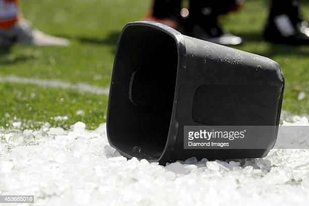 A bucket lies on top of ice on the field after members of the Cleveland Browns took part in the 'Ice bucket Challenge' to help raise awareness for...
