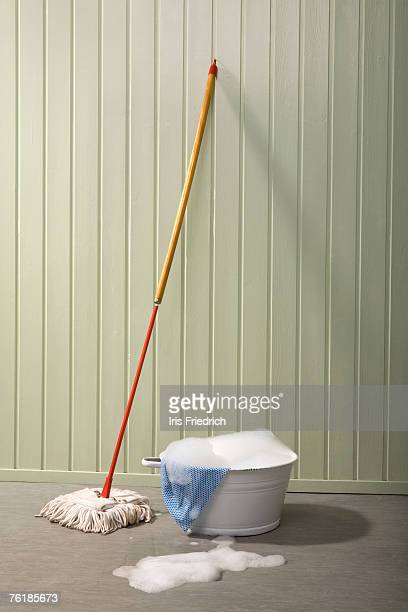 A bucket of soapy water and a mop