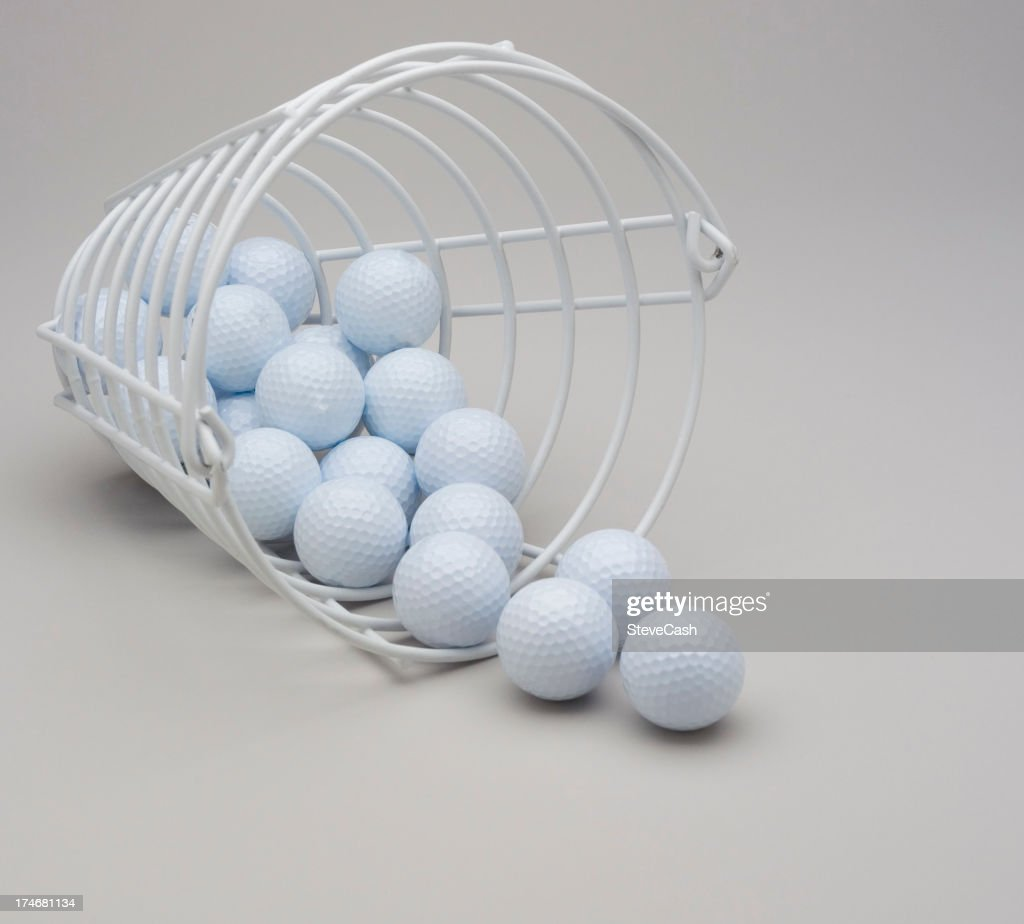bucket of white golf balls stock photo getty images