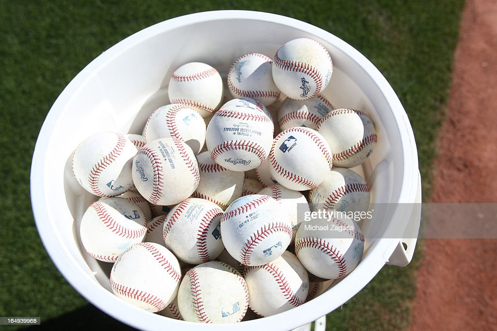 A bucket off ball sits on the field during a spring training workout for the Oakland Athletics at Phoenix Municipal Stadium on February 26, 2013 in Phoenix, Arizona.