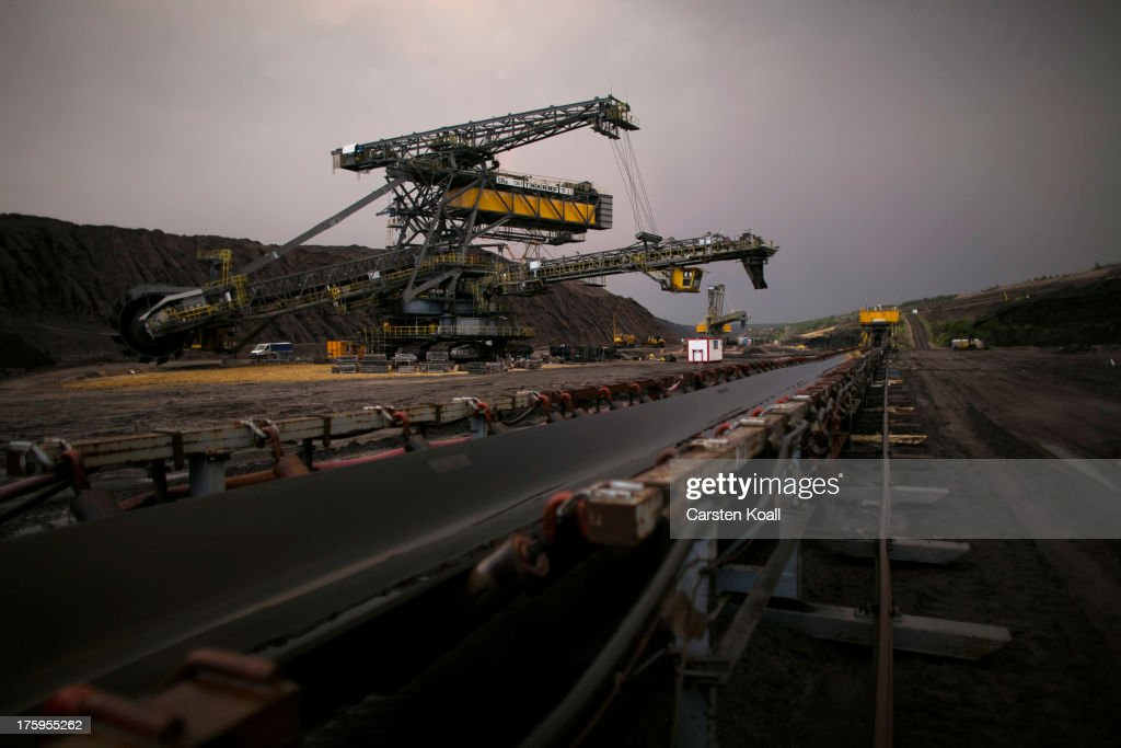 A bucket wheel excavator mines lignite coal at dusk in the Welzow open-pit lignite coal mine on August 10, 2013 near Welzow, Germany. The mine, operated by Vattenfall, is one of several in the immediate area that feed a nearby power plant with coal. In a development project initiated by state government, other nearby former open-pit mines have been turned into lakes in a rejuvenation effort that is also intended to make the area a viable tourist destination.