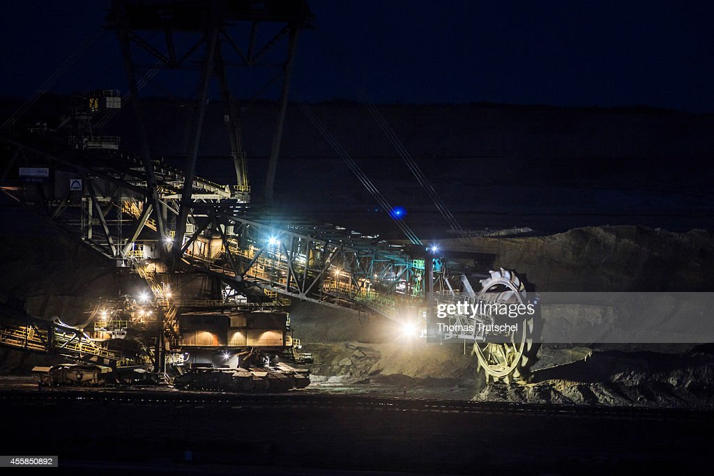 Bucket wheel excavator removing soil in the lignite opencast mining Welzow Sued at night which is operated by Vattenfall Europe Mining AG on...