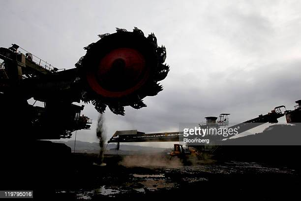 A bucket wheel excavator sits under repair at the PT Bukit Asam open pit coal mine in Tanjung Enim South Sumatera province Indonesia on Thursday July...