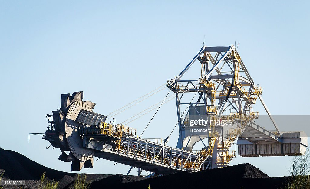 A bucket wheel reclaimer operates at the Newcastle Coal Terminal in Newcastle, north of Sydney, Australia, on Friday, May 3, 2013. Australia's forecast mining tax revenue has been downgraded, underscoring the 'grave' budget decisions facing Prime Minister Julia Gillard as the strength of the local dollar squeezes trade-exposed businesses. Photographer: Ian Waldie/Bloomberg via Getty Images