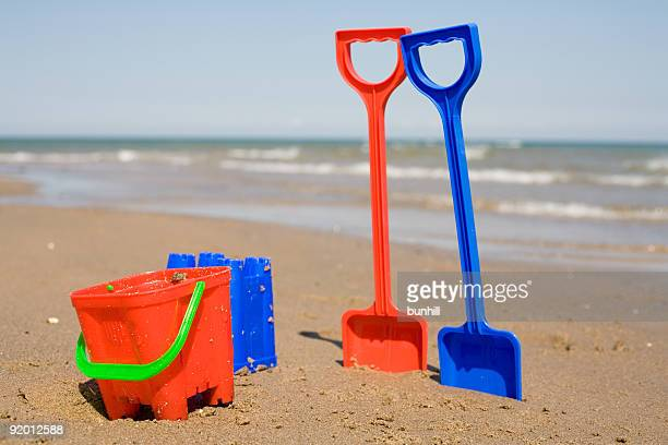 Buckets And Spades In The Sand At Beach
