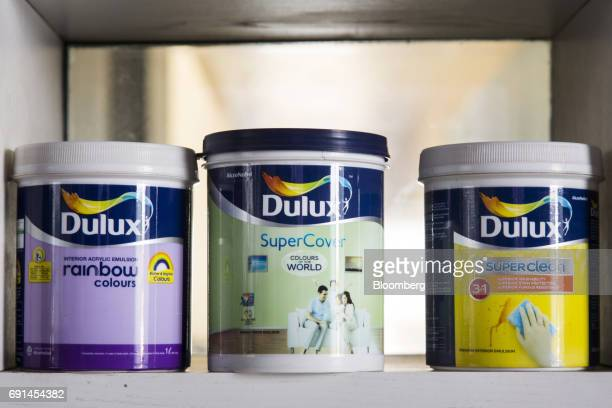 Buckets of Dulux branded paint sit on a shelf at an Akzo Nobel India Ltd factory in Gwalior Madhya Pradesh India on Thursday June 1 2017 Akzo Nobel...