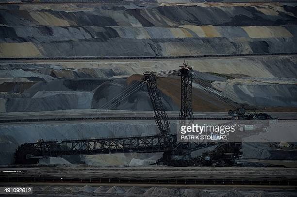 A bucketwheel excavator extracts brown coal from an open cast mine at the power plant 'Weisweiler' on October 2 2015 in Weisweiler western Germany...