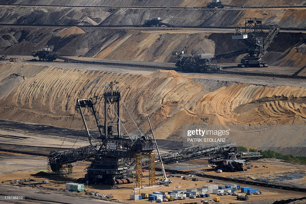 A bucket-wheel excavator extracts coal from the brown coal open cast mine Garzweiler on August 5, 2013 in Immigrath, western Germany. The small town Immerath and surrounding towns will be wiped off the map to allow energy giant RWE enlarge the huge open pit mine Garzweiler.