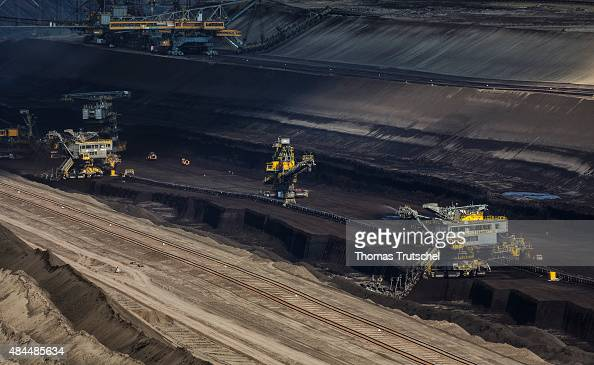 Bucketwheel excavators extract lignite coal at the Welzow Sued openpit lignite coal mine on August 07 2015 in Welzow Germany