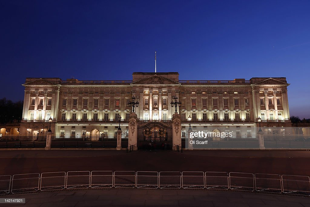 Buckingham Palace, seen from the Queen Victoria Memorial, is illuminated at night on March 29, 2012 in London, England.