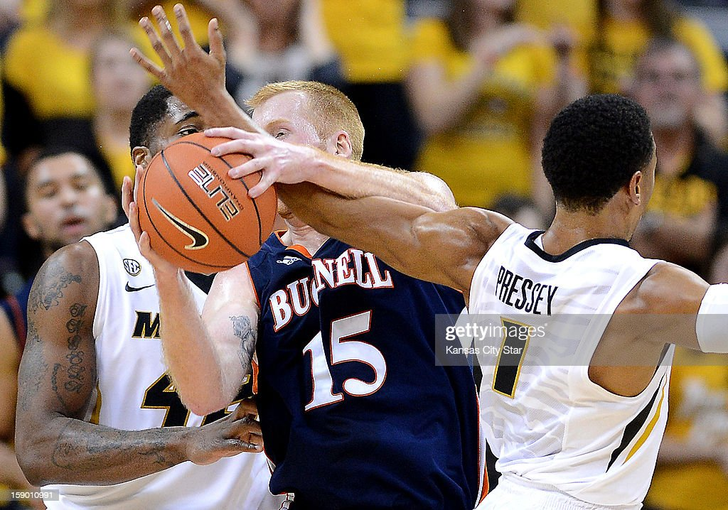 Bucknell's Joe Willman (15) gets tangled up with Missouri's Phil Pressey, right, and Alex Oriakhi in the first half at Mizzou Arena in Columbia, Missouri, Saturday, January 5, 2013. Missouri defeated Bucknell, 66-64.