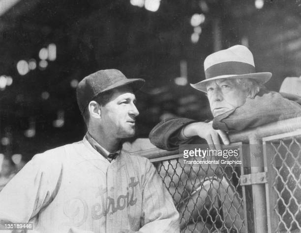 Bucky Harris Hall of Fame manager and parttime infielder for the Detroit Tigers left talks with baseball commissioner Judge Landis at Briggs Field in...