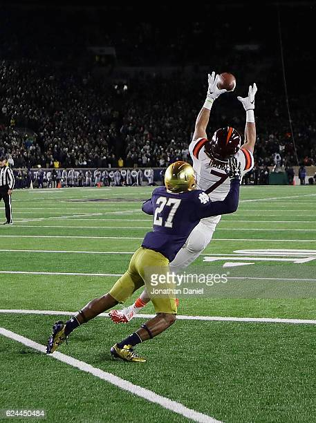 Bucky Hodges of the Virginia Tech Hokies catches a tpouchdown pass in front of Julian Love of the Notre Dame Fighting Irish at Notre Dame Stadium on...
