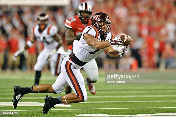 Bucky Hodges of the Virginia Tech Hokies gets his fingers on a pass but is unable to hold on as the pass falls incomplete in the first quarter...