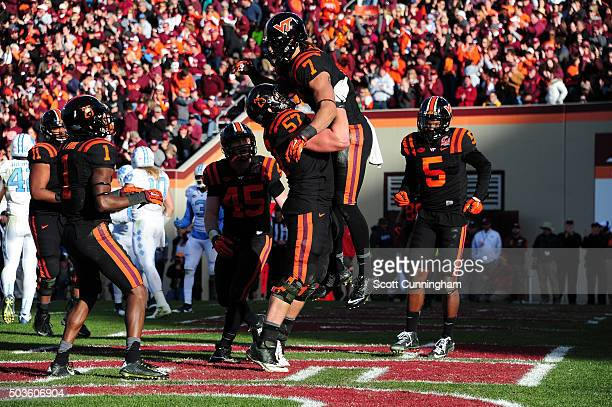 Bucky Hodges of the Virginia Tech Hokies is congratulated by Wyatt Teller after making a catch for a touchdown against the North Carolina Tar Heels...